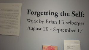 "The ""Forgetting the Self"" Exhibit offers additional  information to viewers who were unable to attend the artist talk. (Photo by Caitlin Sanford)"